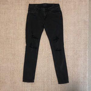 Vigoss dark denim ripped jeans.